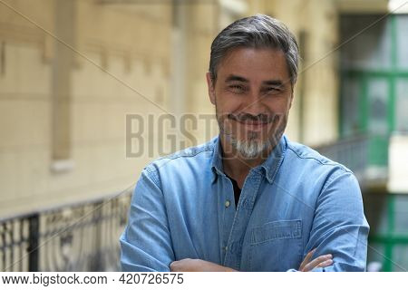 Portrait of mature age, middle age, mid adult man in 50s, happy confident smile. Copyspace, outdoor.