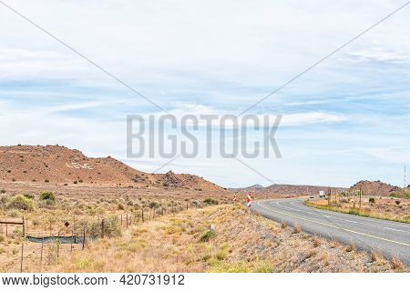 Vehicles Are Visible On Road N1 Between Richmond And Three Sisters In The Northern Cape Karoo. A Cro
