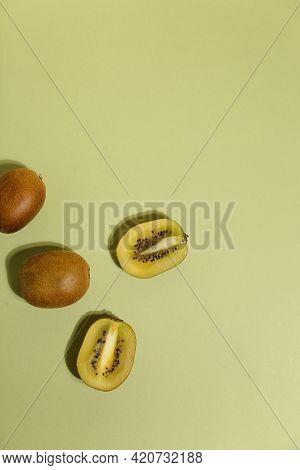 Kiwi, Slices Of Kiwi Fruit On Green Background