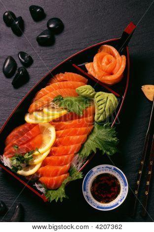 Salmon Sashimi On Black Slate Background