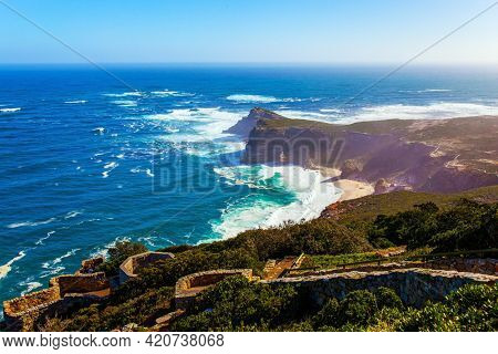 South Africa. Powerful ocean surf. Cape of Good Hope at the southern tip of the Cape Peninsula. White foam of the ocean surf. Bird's-eye view. Bright sunny summer february day