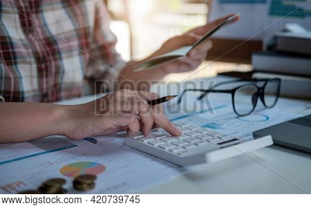 Young Asian Woman Checking Bills, Taxes, Bank Account Balance And Calculating Credit Card Expenses.