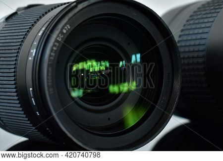 Telephoto Lenses For A Slr Camera Lie On A Glass Table