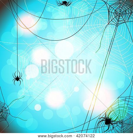 Blue background with spiders and web with space for text