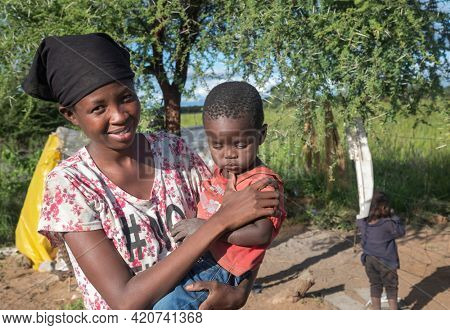 African family mother and children together in a village in Botswana