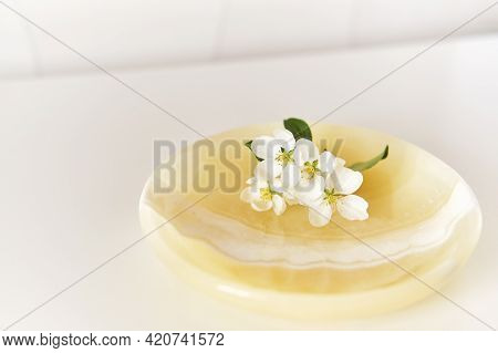 A Beautiful A Sprig Of Apple Tree With White Flowers On An Onyx Plate. Abstract Spring Composition.