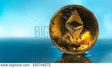 Cryptocurrency Concept. Ethereum, Eth Crypto Currency Coin. Shiny Golden Coin Closeup. Copy Space.