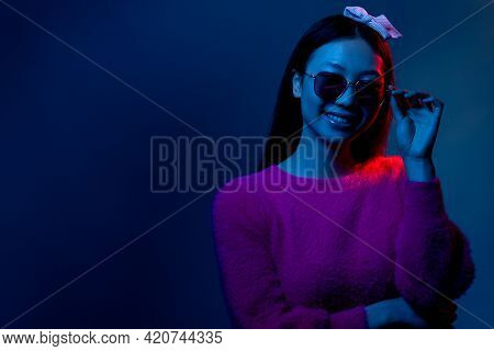 Dark Neon Portrait. Eyewear Fashion. Cyberpunk Beauty. Blue Red Light Happy Smiling Glamour Chinese