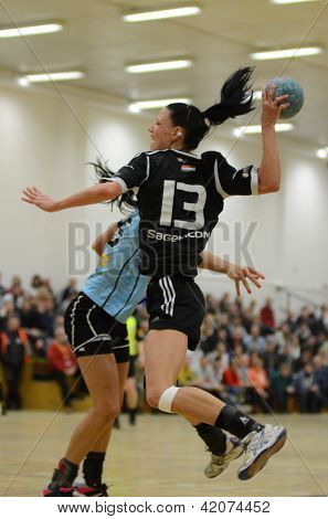 SIOFOK, HUNGARY - FEBRUARY 9: Babett Szalai (black 13) in action at a Hungarian National Championship handball match Siofok KC (black) vs. Fehervar KC (blue) February 9, 2013 in Siofok, Hungary.
