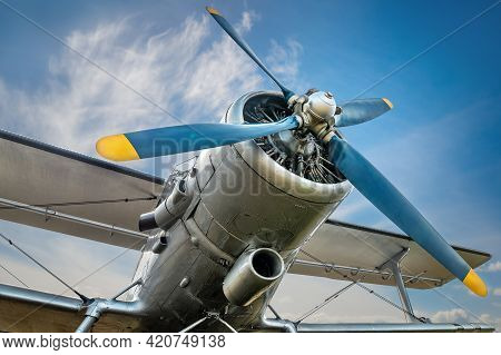 Propeller Of An Historical Airplane Against A Blue Sky
