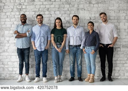 Group Portrait Of Diverse Millennial Team Of Employees
