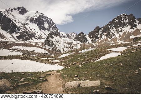 Trail In Tien Shan System In Kazakhstan Near The City Of Almaty. Rocky Peaks Covered With Snow And G