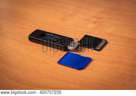 Flash Drive. Memory Card.wood Background.memory Drives On The Table