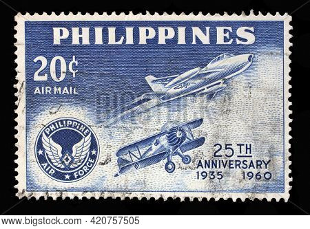 ZAGREB, CROATIA - SEPTEMBER 18, 2014: Stamp printed in Philippines shows Air force plane of 1935 and Saber jet, Series 25th Anniversary of Philippines Airforce, circa 1960
