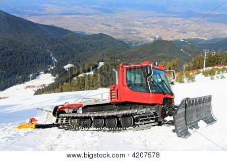 Big snow groomer equipment in snowy mountain poster