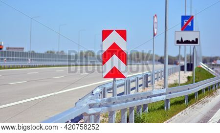 Safety Barriers On The Highway. Anodized Safety Steel Barrier On Freeway Bridge.
