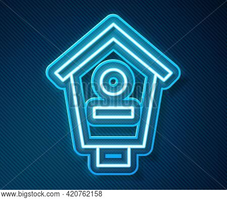 Glowing Neon Line Bird House Icon Isolated On Blue Background. Nesting Box Birdhouse, Homemade Build