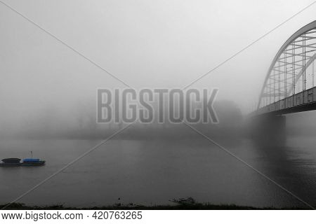 Fog Over The Tisza River On A Cloudy December Morning In Szeged, Hungary.