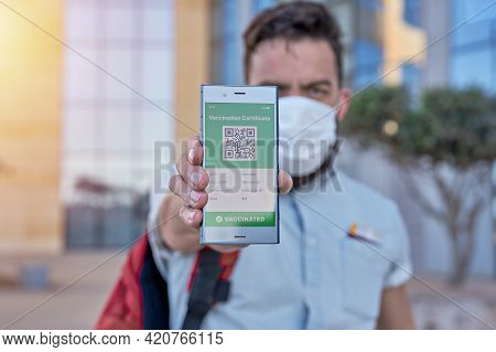 Man Holding Smartphone Displaying On App Mobile Valid Digital Green Vaccination Certificate For Covi