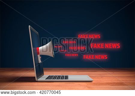 Fake News And Their Impact To The Public And Policy Concept. Notebook With Megaphone And Text Fake N