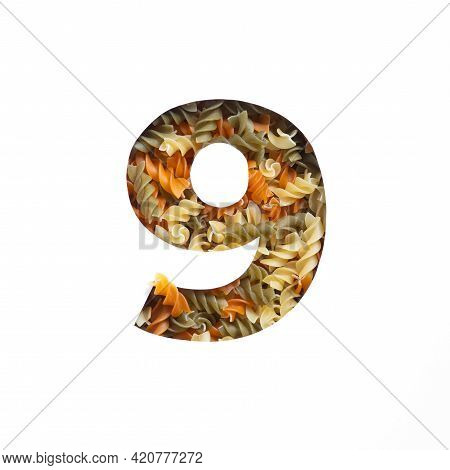 Number Nine Made Of Fusilli Pasta, White Cut Paper In Shape Of Ninth Numeral. Typeface Of Nutritious