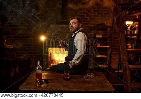 Man smokes a cigar, tobacco smoking culture