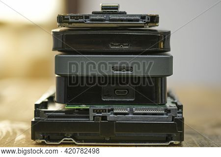 Satck Of Hdd Memory Storage Devices Over Dark Surface, Tech Components, Usb, Memory