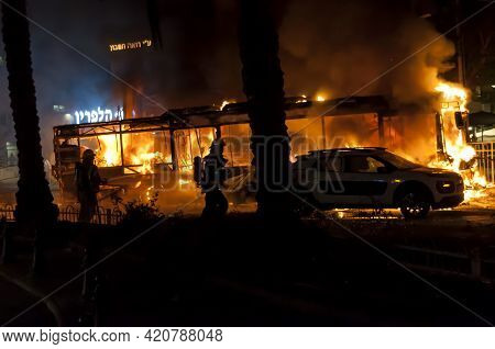 Holon, Israel. May 11, 2021. Burning Bus And Cars, Immediate Aftermath Of The Palestinian Rocket Hit