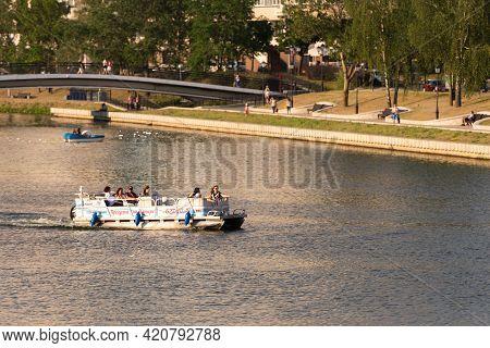 Minsk. Belarus. Summer 2019. Vacationers On The Svisloch River In The Center Of Minsk In Hot Summer.