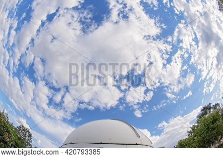 Round Dome Of An Observatory With Clouds Above, Photographed With A Fisheye Lens