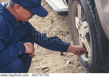 Mechanic Man Hands Checking Car Tires Outdoor On Site Service Auto Garage For Automotive Mobile Cent