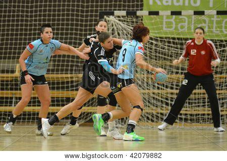 SIOFOK, HUNGARY - FEBRUARY 9: Tamara Tilinger (blue 9) in action at a Hungarian National Championship handball match Siofok KC (black) vs. Fehervar KC (blue), February 9, 2013 in Siofok, Hungary.