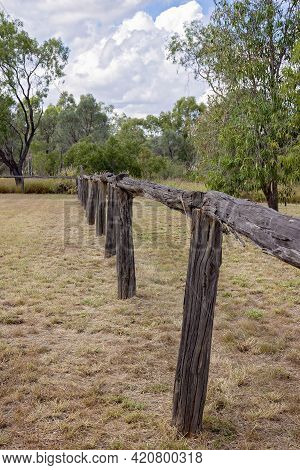 An Old Timber Fence Relic Of A Bygone Era Standing In A Grassy Field