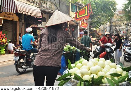 Vietnam Woman People Push Bicycle Cart Hawker On Road Sale Guava Fruits To Vietnamese People And For