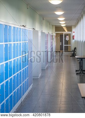 15.02.2021 Koblenz Germany Empty Hallway With Colored Lockers And Door Room At School Or University