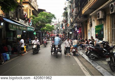 Vietnamese People Riding Biking Driving And Foreign Travelers Walking Travel Visit Old Town And Shop