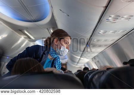 Russia Moscow 2021-03-01 Caucasian Beautiful Woman Stewardess In Face Mask, Blue Uniform