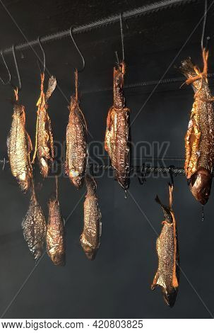 The Fish Is Smoked In A Smokehouse. Smoking Oven. Abkhazia. Smoked Products.