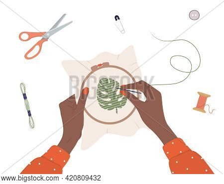 Embroidery Process. Workshop, Needlework And Knitting. African Female Hands With Needle And Thread.