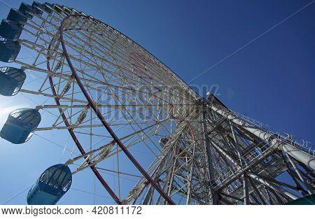 Ferris Wheel Gondola Ride On A Sunny Blue Sky Day
