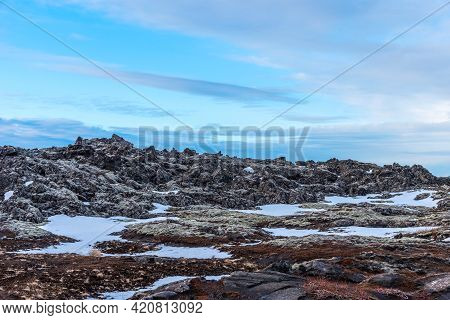 Outside Blue Lagoon In Iceland. The Blue Water Between The Lava Stones In Iceland. Hot Springs Blue