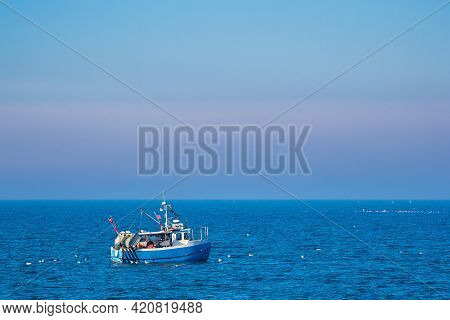 Fishing Boat And Sea Gulls On The Baltic Sea In Warnemuende, Germany.
