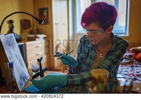 Geek Teenage Girl In Protect Eyeglasses Engineering An Airplane Model At Home, Generation Z Lifestyl