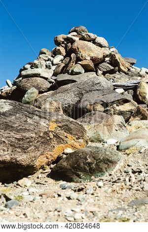 Cairn Or Pyramid Man-made Pile Or Stack Of Stones On Top Of Mountains In Kyzyl-chin In Altai Republi