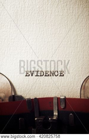 The word evidence written with a typewriter.