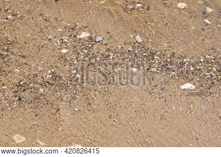 Colorful Rolling Stones Sea, Bottom Pattern . Stones Under The Sea Water. Clean Coast. Clean Bottom