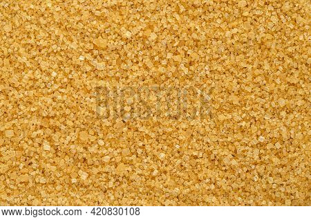 Brown Demerara Sugar, Background, From Above. Coarse, Crystalline, Natural And Raw Sugar, A Sucrose
