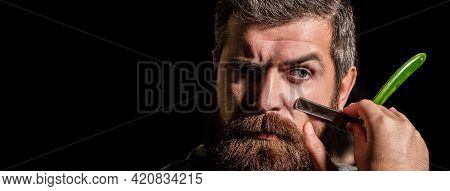 Vintage Straight Razor. Mens Haircut. Man In Barbershop. Handsome Bearded Hairdresser Is Holding A S