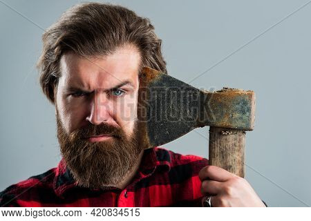 Perfect Beard. Logger Or Axeman Concept. Brutal Bearded Man Lumberjack In Checkered Shirt