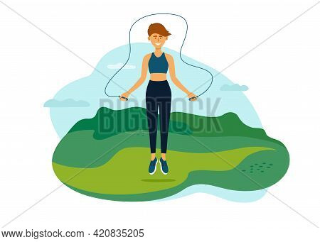 Outdoor Physical Activity On Fresh Air. Young Woman Jumping In Park With Jump Ropes. Female Training